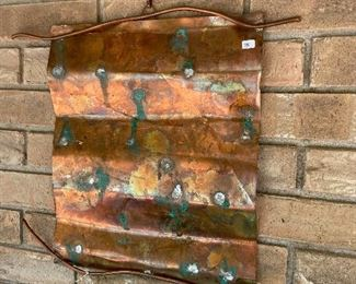 Original copper wall hanging by Susie Henley.