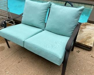 Aluminum framed love seat with new cushions.