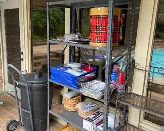 Metal shelving, lots of picnic supplies.