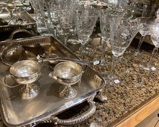 Multiple pieces of sterling and plate along with etched crystal stemware.