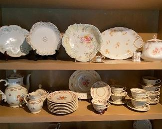 Shelves full of antique painted china.