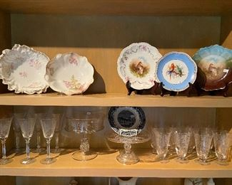 Painted china and etched crystal stemware.