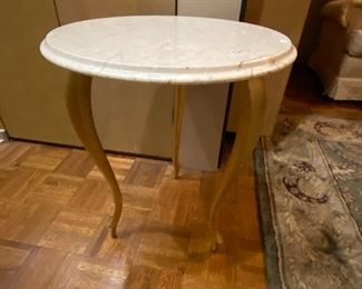 Gilded gold legged marble table.