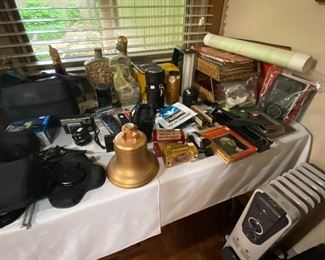 Cameras, books, old decanters, maps,