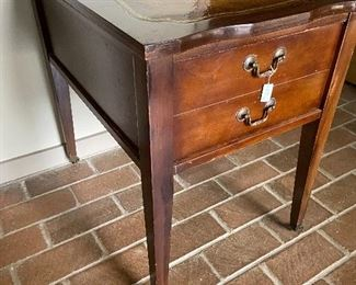 Leather top side table on small casters.