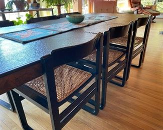 Beautiful modern dining room table with burled wood top