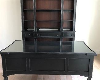 "Like new Stanley office furniture set. Beautiful black with wood backing on wall unit. Desk-32"" deep x 62.5"" wide x 31"" high. Wall unit 67"" wide x 89"" high x 16"" deep.  $990"