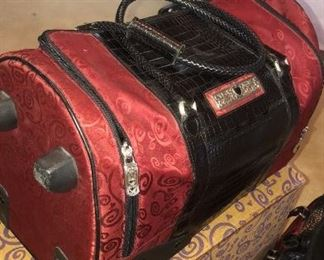 super nice brighton side wheeler duffle and matching cosmetic bag in ruby  and black w/ original box