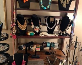 This is just a sampling of the costume jewelry we've got.  This is just a taste of the gorgeous necklaces. If only I was a giraffe then I could wear all of them at the same time.  Fun fact - even as long as their necks are, they can't reach the ground, so they have to do awkward splits just to drink water.