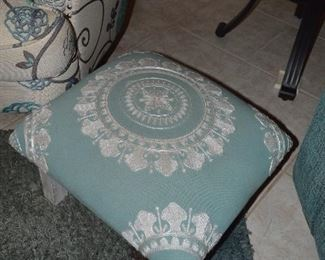 There are two of these padded footstools