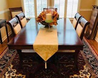 $595, Ashley dining table with one leaf, pads and 6 chairs