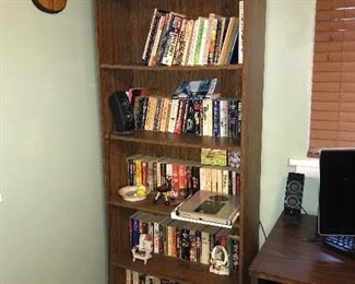 Paperback books and book case