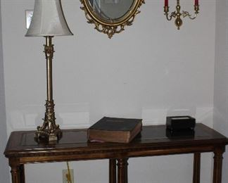 """Traditional Sofa Table with Bevel Glass Pane (2) Top.  (48""""W x 16 1/2""""D x 27""""H). Also shown OBI Gold Leaf Buffet Table Lamp (33""""H) and Syroco 1967 Gold Oval Wall Mirror"""