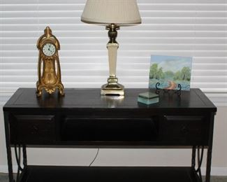 "Metal Base Wood Espresso Console/TV Table  (25""H x 46""W x 18""D). Shown with Antique Jennings Bros  Metal Foundry Art Nouveau Clock, Brass Table Lamp and Original Blue Bonnet Texas Landscape Artwork on Contton Canvas Panel (8""x10"")"