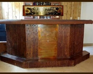 Custom Vintage Copper and Wood Bar with Plaque that reads; Bar Bazaar Original Exclusively Designed by Isabel. The Bar's Footrest is Copper, the front plate is Copper and the Top is Copper, Very Cool!! Lots of Storage Available Too!