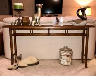 """PRICE: $80.00 Console Sofa Table with removable Beveled glass Top. Rattan styling in  what looks to be Mahogany.  Measures: 27.5""""Tall • 14.5""""Deep • 56""""Long  Item#65470"""