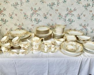 90+ piece lot Noritake gold and white Christmas Ball pattern #1634. Condition: Very good, no known chips. Measures: largest piece platter 16W and smallest are s/p at 3.5H. Price: $350.