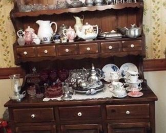 """20.  DARK WOOD WITH PORCELAIN KNOBS CHINA CABINET 50"""" X 18 1/2"""" X 75""""    $200.00"""