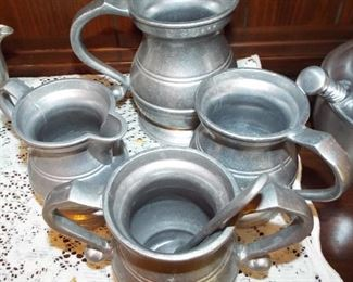 21.  4 PC. HANDLED PEWTER +SPOON  $35.00