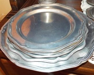 23.  4 PEWTER PLATES + 1 PEWTER SERVING PLATE  $20.00
