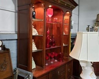 """Gorgeous Lighted cherry 2 piece china cabinet & hutch with brass molding Measures: 63.25""""W x 22""""D x 95""""H in center Was $995 Now $695"""
