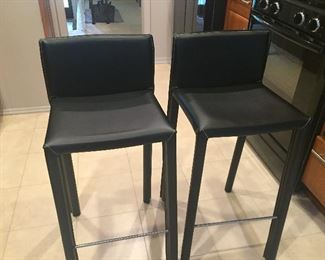 Pair of Gerog Jensen Leather Chairs $200.