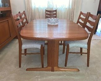 The Vintage  Dyrlund Teak Dining Room is sold as a set. The price for China Cabinet, Dining Table with leaves & 6 Chairs  $2800.00