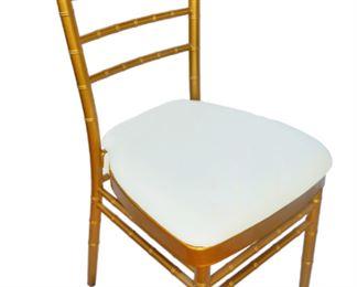 Gold Chiavari chairs with ivory cushions!