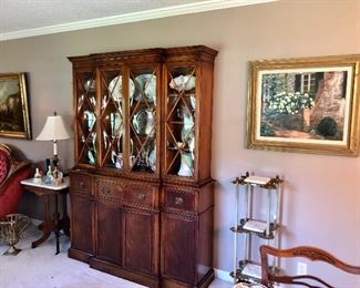 Family has decided to keep mahogany breakfront.  All other antiques are available.