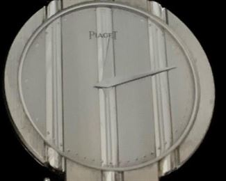 Vintage Piaget, 18K white gold watch with black leather band.