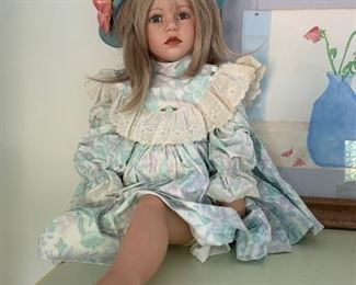 $15 for outfit & wig doll has one leg