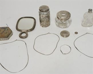 1175STERLING SILVER LOT, PIN CUSHION IN A STERLING HOLDER, HAIR RECEIVER W/ STERLING LID, STERLING SILVER DRESSER MIRROR & A CUT GLASS FLASK OR PERFUME W/ STERLING TOP, JAR W/ SILVER OVERLAY THREE NECKLACES & A BRACLET, A LID, 1939 DIME