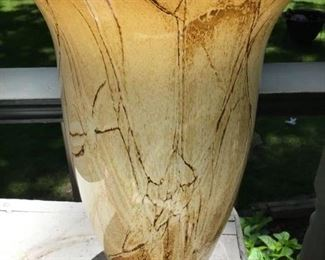 12 inch tall blown glass vase with brown and gold marbleized throughout the vase $30