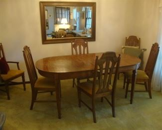 Dining table w/ 3 leaves and 6 chairs. Extends to 96""