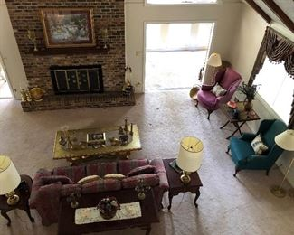 sofa, end tables, pictures, wingback chairs, lamps, coffee tble, fireplace set