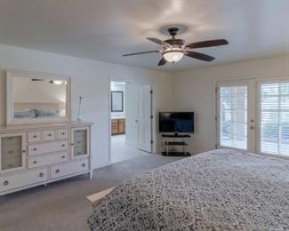 Master Bedroom: King Panel Bed, Dresser w Mirror, Wardrobe and 2 Nightstands, Table Lamps, TV and TV Stand