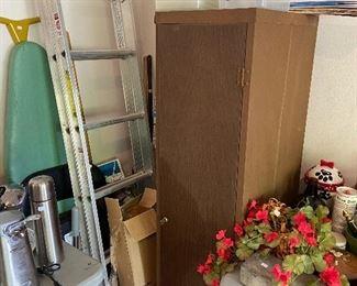 Ladder, storage cabinet.