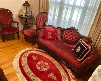 Velvet tufted settee with matching chairs.