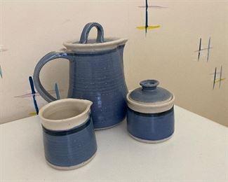 d 4 piece ceramic set signed $ 75.00