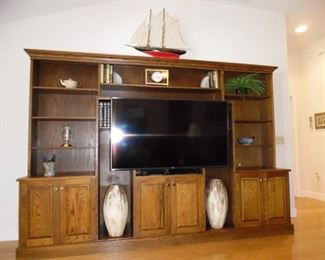 "Entertainment Center shown with a 63"" Samsung.  Will house a larger TV.. TV not for sale - stays with the property"
