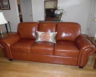 Real Leather, 3 seat sofa. Nail head trim. Like new condition