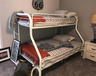Bunk Bed with full on bottom and twin on top. Includes bedding