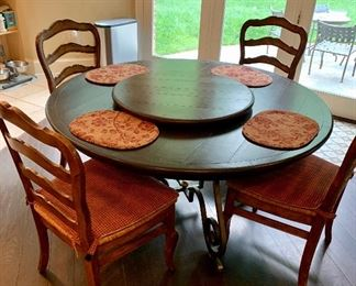 """$1,595 Wrought iron and wood hand crafted table by Creative Metal and Wood.  Table 29.5""""H x '5' Diameter;  16 inch  integrated leaf expands to make oval table.  Detachable matching Lazy Susan 30""""D included."""