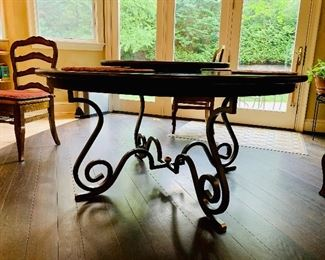 Detail:  Base of Creative Metal & Wood (North Carolina) handcrafted wrought iron and wood round dining table.