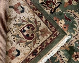 Detail:  Area rug in greens, taupe and cranberry