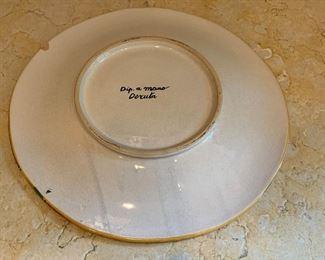 Detail: Deruda plate with chip (upper left)