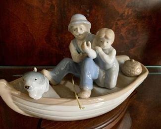 "$20 Porcelain figurine. 8""L"