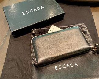 $95 New in Box.  Escada black leather wallet.