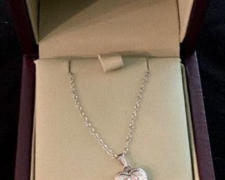 $30 Sterling Silver child's necklace with engraved heart locket pendant.