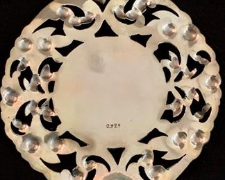 Detail:  Round filigree pendant with angel motif.